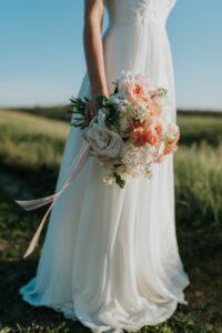 woman-wearing-white-wedding-dress-holding-flower-bouquet-1721944