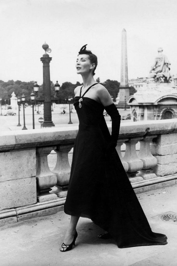 Model wears black dress Christian Dior, 1950s