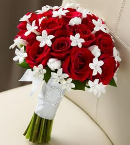 Stephanotis Flower with red roses bridal bouquet